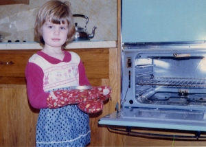 A young cook in the kitchen.