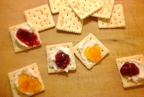 Crackers, cream cheese and jam
