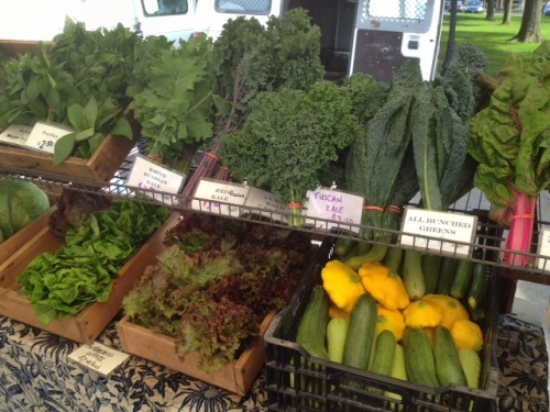 Huge selection of greens at the farmer's market.