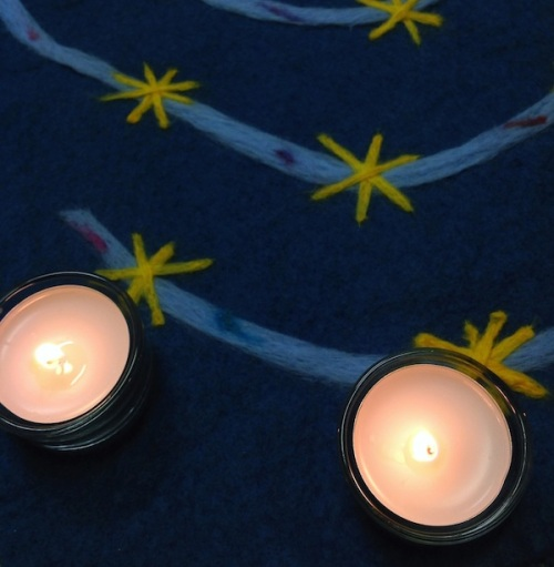 Candles with Advent spiral of stars