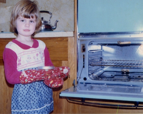 A young me wearing an apron