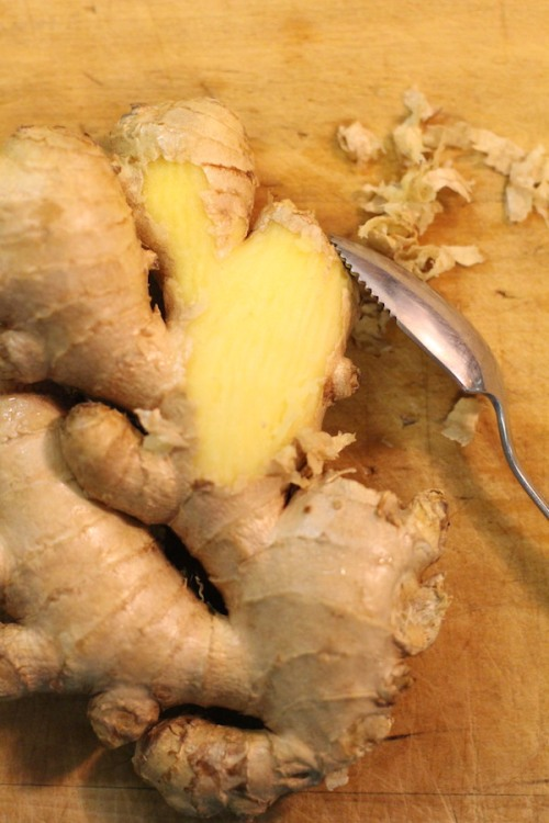 Peeling ginger root with a grapefruit spoon