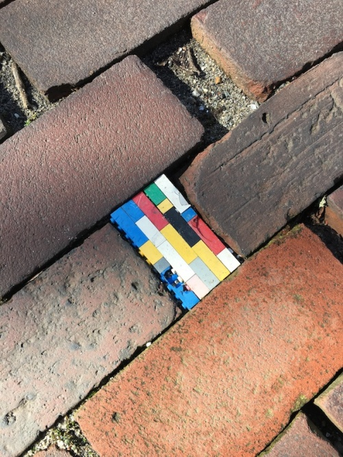 Brick sidewalk on Nantucket with Lego Brick insert.