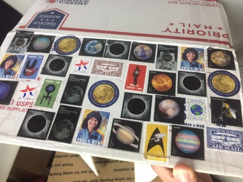 Outer Space stamp theme on mailing box.