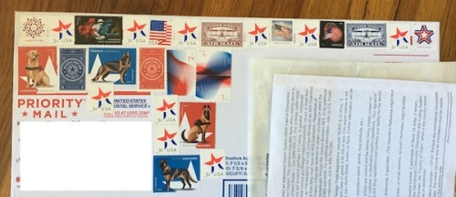 Red, white and blue themed stamps on package.