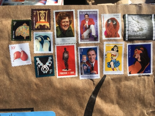 Movie and TV show themed stamps on mailing envelope.